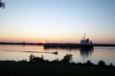 Ship Passing On The St. Lawrence River